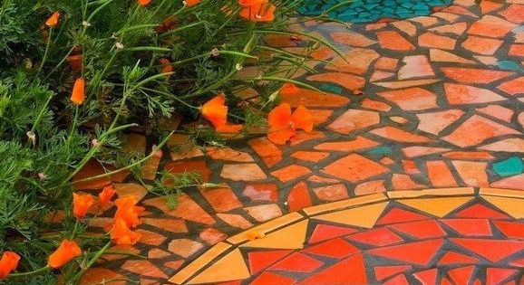 Mosaic garden path. Love the orange color!