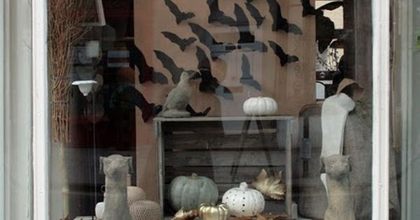 Window decor stylish Halloween look / swarm of black paper bats