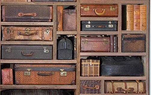 Old suitcases in shelves - pure art!