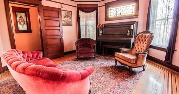 Be transported back in time in this historic victorian for Beautiful sitting rooms