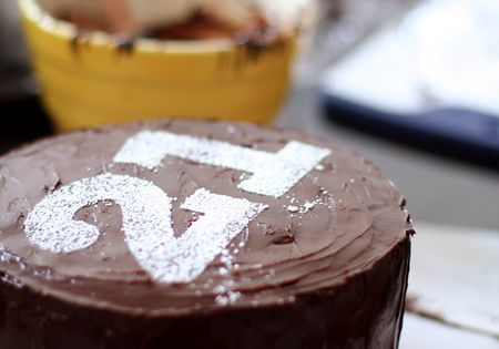 Simple birthday cake decorating idea: powdered sugar over a number stencil