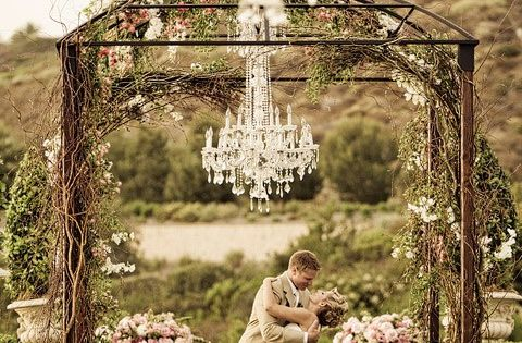 Dream outdoor wedding arbor... Love the chandelier. :)