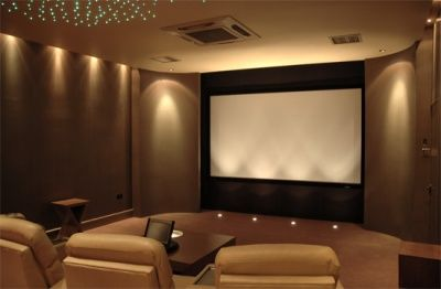 I Like The Gray Walls In This Media Room With The Pop Of Orange For Color Small Media Rooms Home Theater Room Design Media Room Seating