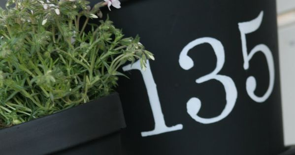 chalkboard paint Love the idea of house number on flower pots.