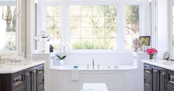 Fabulous contrast between the dark floors and cabinets with the white tub