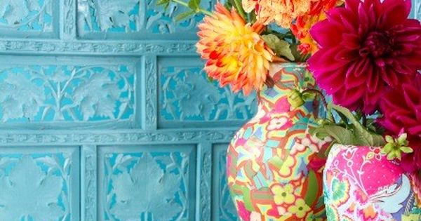 love the turquoise wall next to the vibrant colors in the flowers.