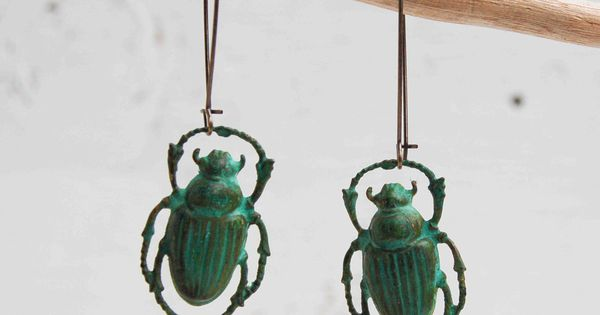These remind me of Moonrise Kingdom... Halloween Steam Punk Green Beetle EARRINGS