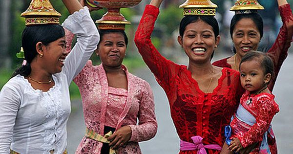Balinese women carrying spectacular fruit displays