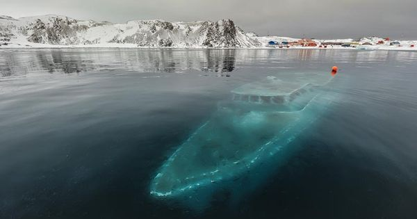 A Sunken Boat in the Antarctic... In this haunting image by Ruslan