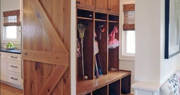 Mud room design with sliding barn door. I WANT! barndoor