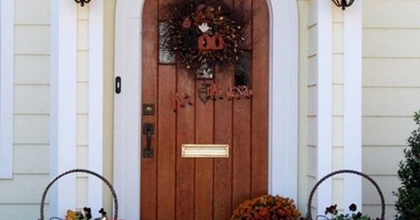 Front entry is so warm - love the shape of the door!