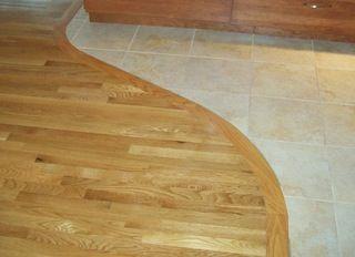 Curved Transition Wood To Tile Hardwood Floors Tile To Wood Transition Entryway Flooring