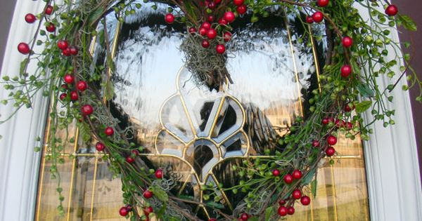 Christmas wreath of greenery and red berries ... heart shape ...