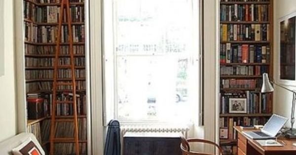 Office space. Love the bookshelves and huge window
