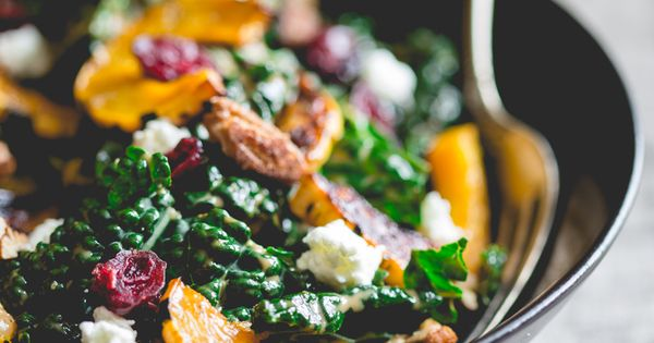 Kale salad with roasted delicata squash, chevre, dried ...