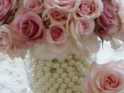 Lovely Centerpiece Idea~ Fill a smaller vase with water and insert your