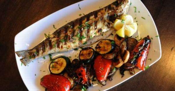 السمك المشوي بالزيت والليمون Tasty Dishes Dishes Delicious