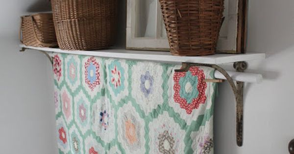 Add A Rod In The Brackets Of A Shelf To Display A Quilt