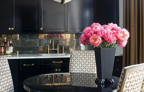 Gold And Black Dining Room Features A Robert Abbey Mary