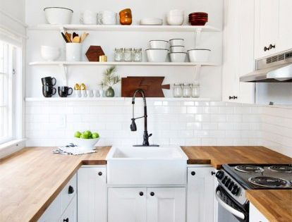 Great layout for a galley kitchen! Clean, classic white subway tile, black