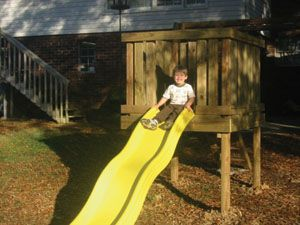 Build A Playground Slide Extreme How To Playground Slide Backyard Playground Playground Backyard Landscaping