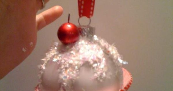 Make your own Cupcake Ornament. Dollar store bulb, cupcake paper, some glitter and ribbon DIY christmas ornament