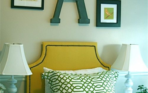 Big letter over bed. eclectic bedroom by Caitlin Creer Interior Design