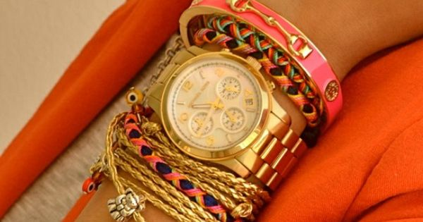 Loving the arm party! Gold and Coral. accessories fashion style