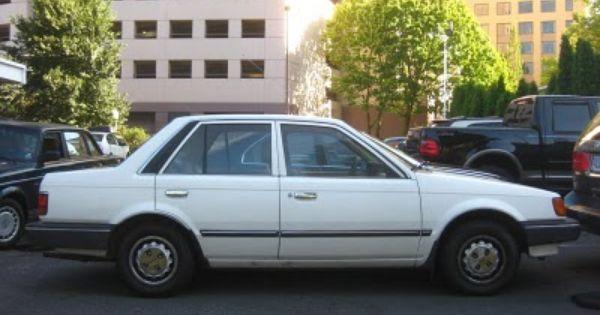 My First Car 1987 Mazda 323 4 Door In Red It Was Such A Great Car 5 Week In Gas Lol Mazda Sedan First Car