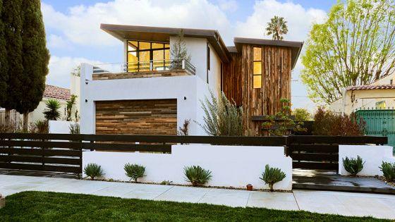 Dise o de moderna casa de dos pisos con aplicaciones de for Casa moderna jardin d el menzah