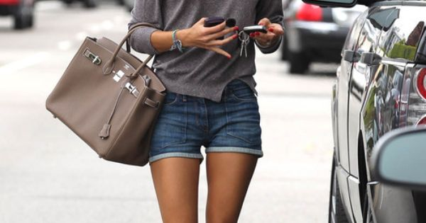 Alessandra Ambrosio grey sweater jeans shorts hand bag sunglasses