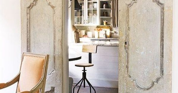 Create pocket doors using old doors and barn door hardware. I love
