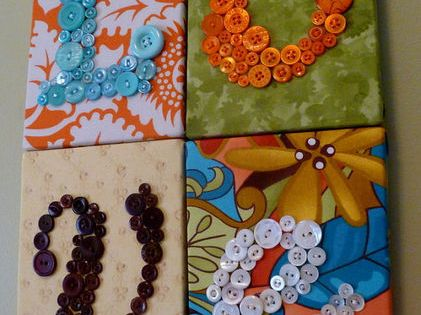 fabric or scrapbook paper on canvas. button letters. perfect for a wall