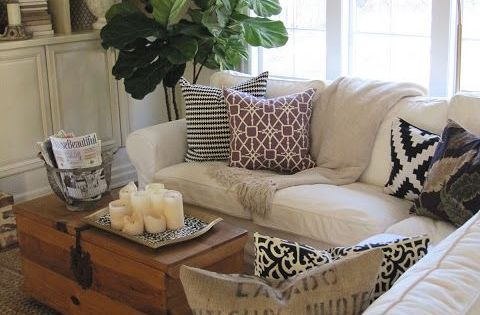 Candlescape On Coffee Table Basket Holding Magazines Remote White Slip Covered Sofa Simple