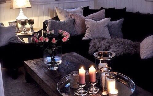 Cozy living room lit with candles - coffee table ideas
