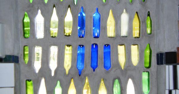 Hundertwasser: Bathroom window with colored glass bottles ...
