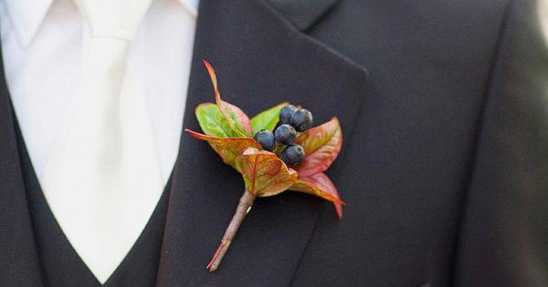 groom's attire black vest, white shirt, white tie