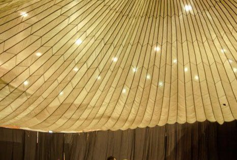 Parachute as ceiling decor. Parachute rental: 35 dollars. Awesome! ---- Great idea