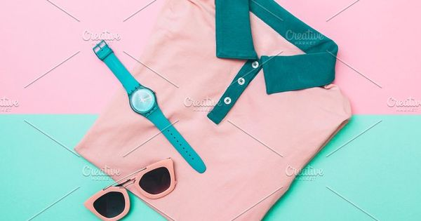 flat lay fashion set of pink tee shirt, sunglasses and mint watches. pastel fashion in trend. minimal