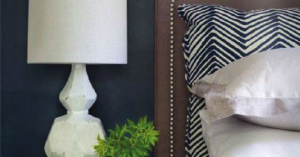 Navy Walls + Upholstered Headboard + West Elm Lamp + Chevron hotel