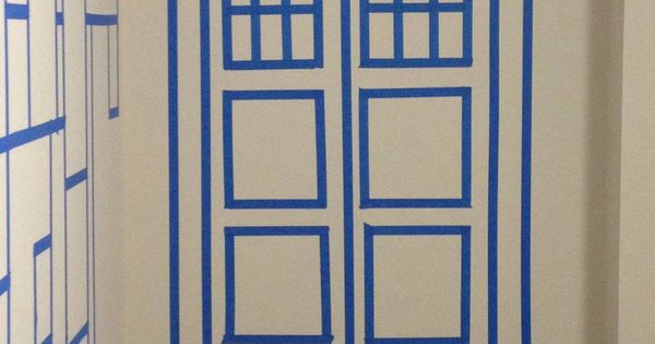 TARDIS on the wall with painter's tape- what a fun party idea-