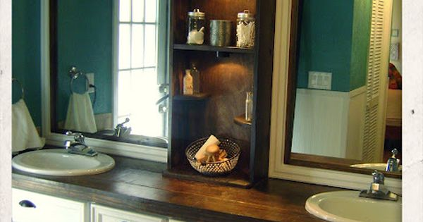 Beautiful bathroom makeover. I love the center shelving. Great for a Master