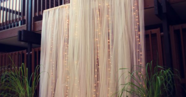 Beautiful backdrop for a ceremony or head table. Dramatic Tulle and Lights