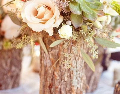 "Tree stump ""vases"" filled with flowers as your fall wedding centerpiece. Whimsical"