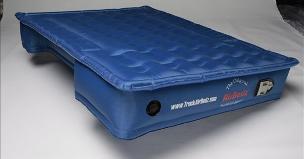 Truck bed air mattress. Cut outs for the wheel wells. outdoors