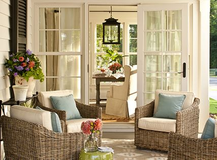 Patio outside of the sunroom: source: Southern Living Covered porch with black
