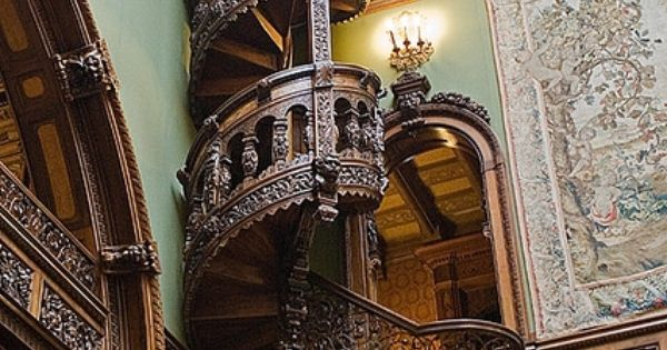 Wooden spiral staircase. Library, Pele's Castle, Romania.