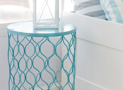 spray paint trash can, flip, instant side table! Cute for outside too!