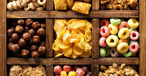 Variety of cold cereals in a wooden box, quick breakfast for kids overhead shot (Cheerios inspired)