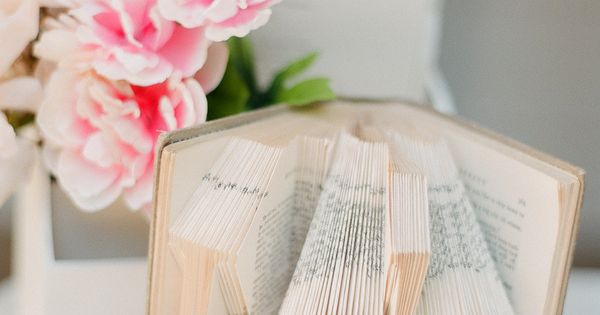 "Book pages are folded to say ""I Do"" ~ Photography by stephenpappasphot..."